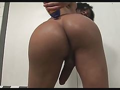 Tranny Jo Garcia Oils up and Wanks her Immense Knob