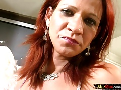 Redhead  in colorific  milks in the kitchen
